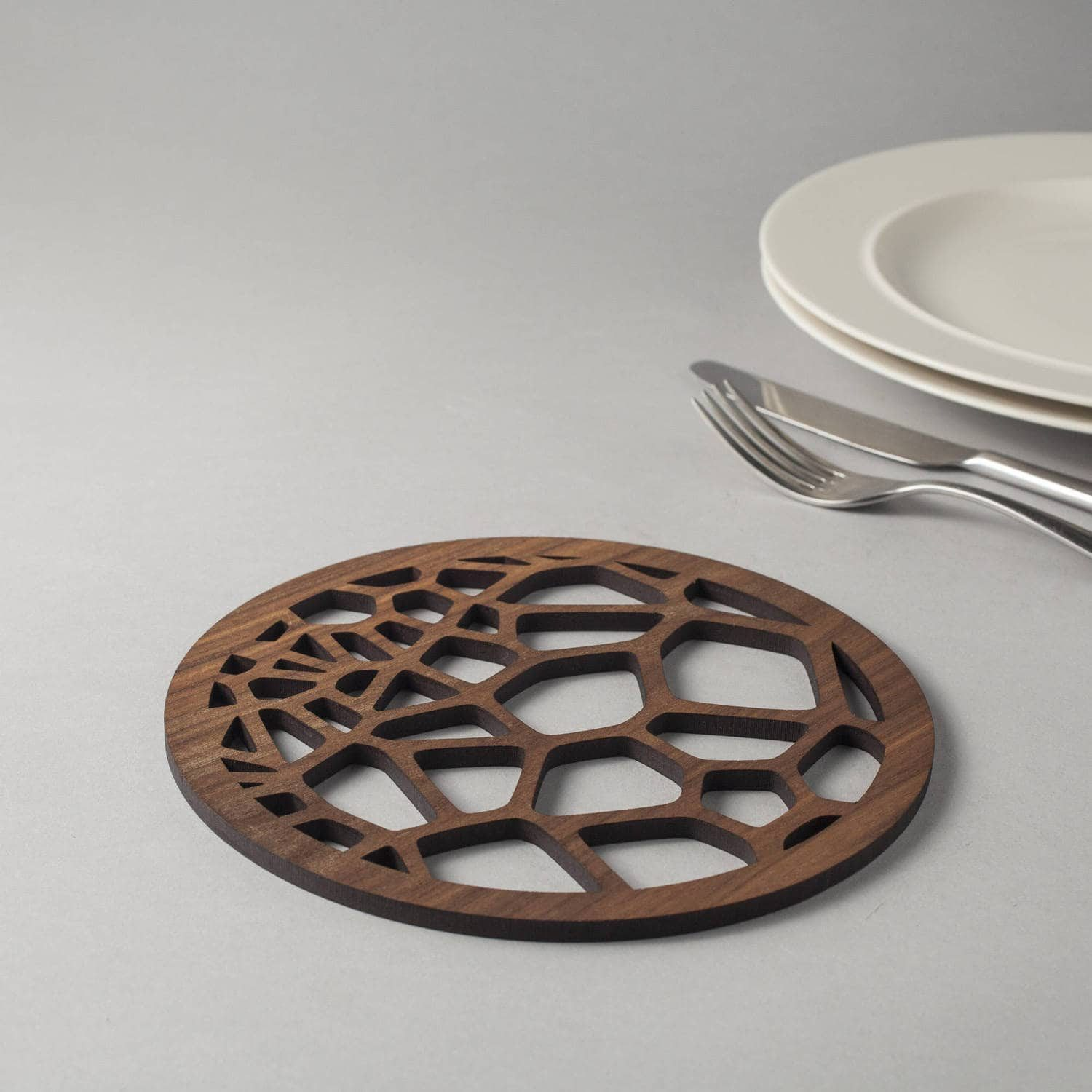 Voronoi cell pattern coasters in genuine walnut, geometry, cells