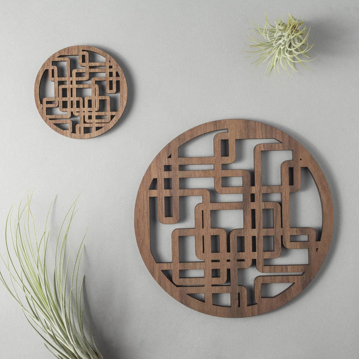 "Walnut ""plumber's nightmare"" drinks coasters, geometric"